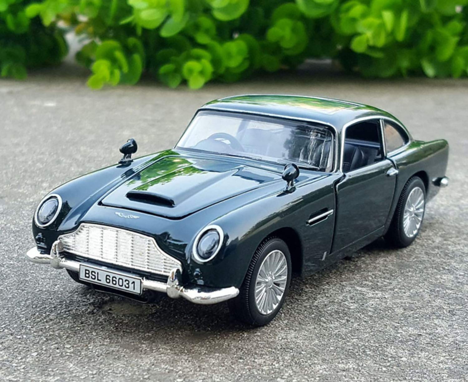 Magicwand 1 32 Scale Die Cast Aston Martin Db5 Goldfinger With 4 Openable Doors Music Lights Pull Back Action Color May Vary Buy Online In Bolivia At Desertcart Bo Productid 217096969